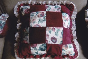 Red and flowers patchwork cushion